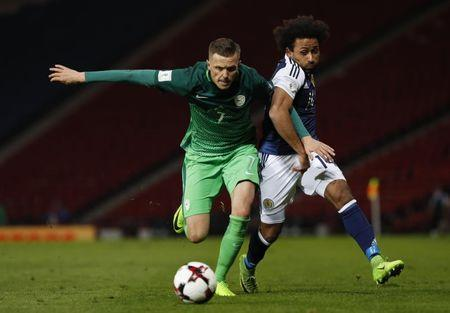 Britain Football Soccer - Scotland v Slovenia - 2018 World Cup Qualifying European Zone - Group F - Hampden Park, Glasgow, Scotland - 26/3/17 Slovenia's Josip Ilicic in action with Scotland's Ikechi Anya Reuters / Russell Cheyne Livepic