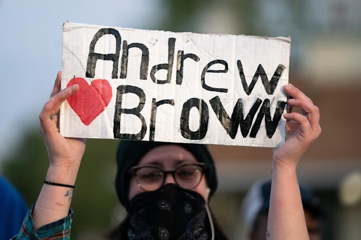 <p>ELIZABETH CITY, NC - APRIL 22: A demonstrator holds a sign for Andrew Brown Jr. during a protest march on April 22, 2021 in Elizabeth City, North Carolina. The protest was sparked by the police killing of Brown on April 21.</p> ( (Photo by Sean Rayford/Getty Images))