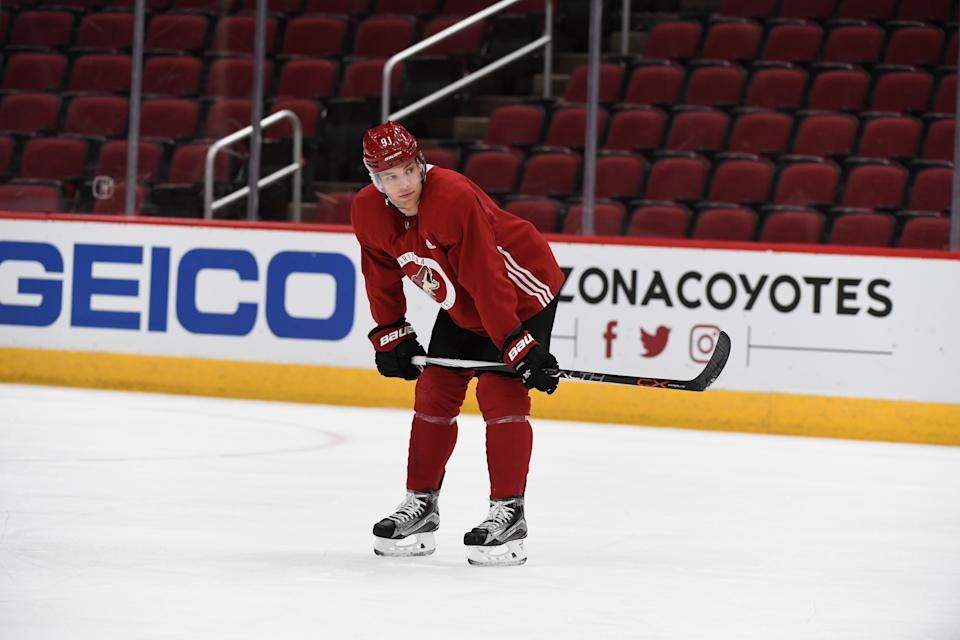 GLENDALE, ARIZONA - DECEMBER 18: Taylor Hall #91 of the Arizona Coyotes looks up ice during practice at Gila River Arena on December 18, 2019 in Glendale, Arizona. (Photo by Norm Hall/Getty Images)