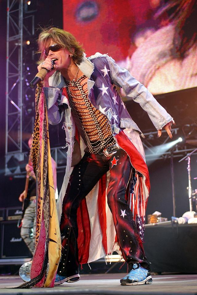 <p>Steve Tyler of Aerosmith performs during United We Stand Concert – Show at RFK Stadium in Washington DC, United States. (Photo by KMazur/WireImage) </p>