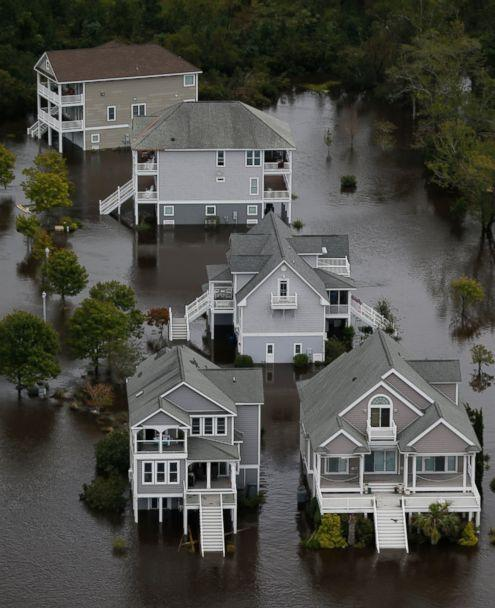 PHOTO: Homes along the New River are flooded as a result of high tides and rain from Hurricane Florence which moved through the area in Jacksonville, N.C., Sunday, Sept. 16, 2018. (AP)