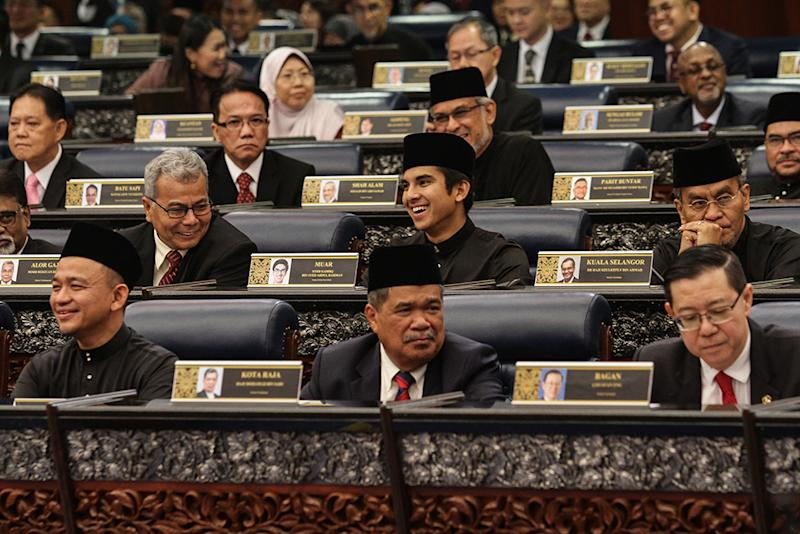 Members of Parliament are seen during the swearing-in ceremony in Parliament today, July 16, 2018. — Picture by Miera Zulyana