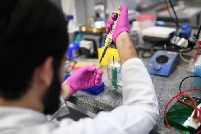 FILE PHOTO: A researcher from the Institute of Biology at the Federal University of Rio de Janeiro (UFRJ) works to develop a new test to detect coronavirus infections in people, in Rio de Janeiro