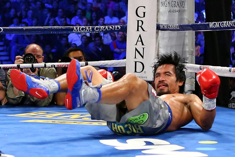 LAS VEGAS, NV - DECEMBER 08: Manny Pacquiao is knocked down in the third round while taking on Juan Manuel Marquez during their welterweight bout at the MGM Grand Garden Arena on December 8, 2012 in Las Vegas, Nevada. (Photo by Al Bello/Getty Images)