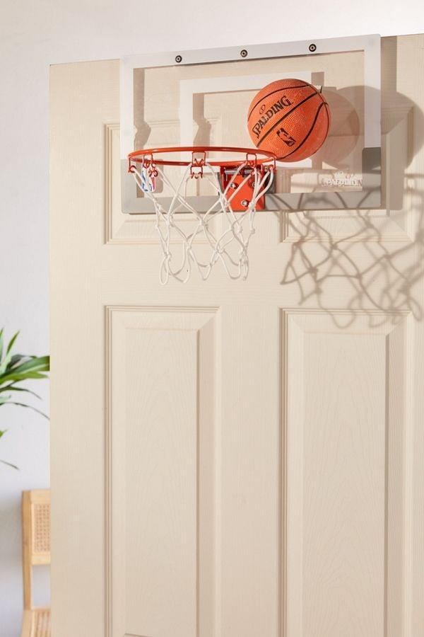 <p>Feed his inner child with this <span>Spalding Over-The-Door Slam Dunk Mini Basketball Hoop</span> ($35).</p>