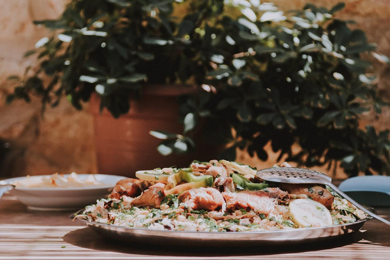 <p>If you aren't already a fan of Middle Eastern food, Jordan will help you get there. Rich with spices, there's a variety of dishes to try. Eat your fill of hummus, falafel, shawarma, or my favorite, Maqluba, which is made with rice, meat, pine nuts, and lemon.</p>