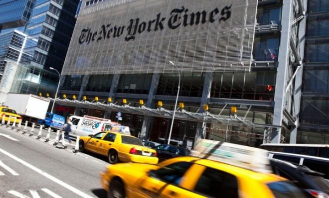 Traffic rushes past The New York Times headquarters in New York City.
