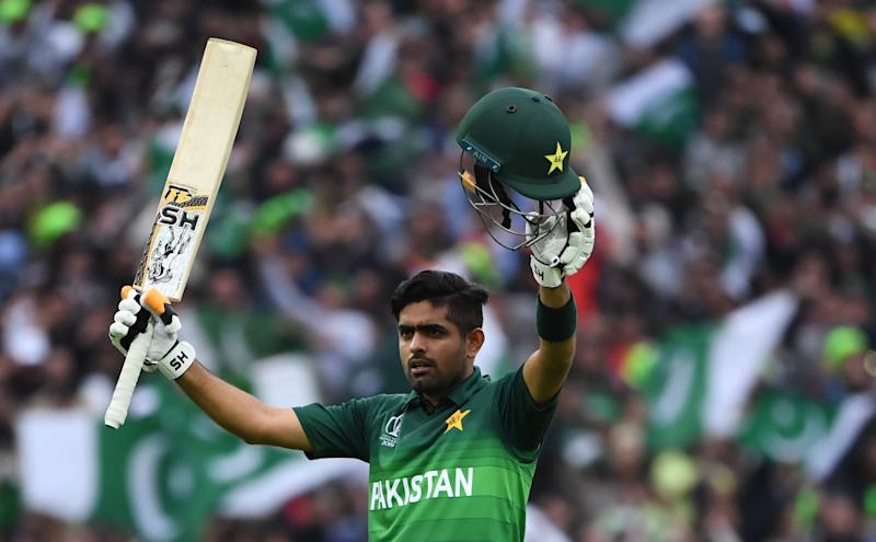 Pakistan's Babar Azam celebrates after scoring a century (100 runs) during the 2019 Cricket World Cup group stage match between New Zealand and Pakistan at Edgbaston in Birmingham, central England, on June 26, 2019. (Photo by Paul ELLIS / AFP) / RESTRICTED TO EDITORIAL USE (Photo credit should read PAUL ELLIS/AFP/Getty Images)
