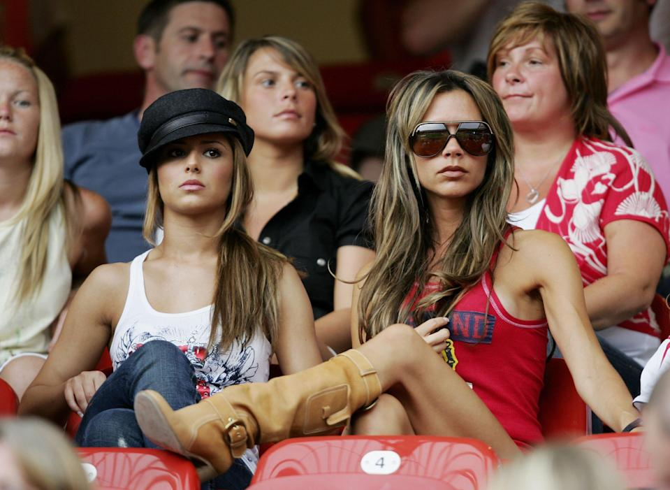 Cheryl (then) Tweedy and Victoria Beckham watching a match at the 2006 World Cup. [Photo: Getty]