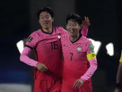 South Korea's Hwang Ui-jo, left, celebrates his goal with teammate Son Heung-min against Turkmenistan during their Asian zone Group H qualifying soccer match for the FIFA World Cup Qatar 2022 at Goyang stadium in Goyang, South Korea, Saturday, June 5, 2021. (AP Photo/Lee Jin-man)