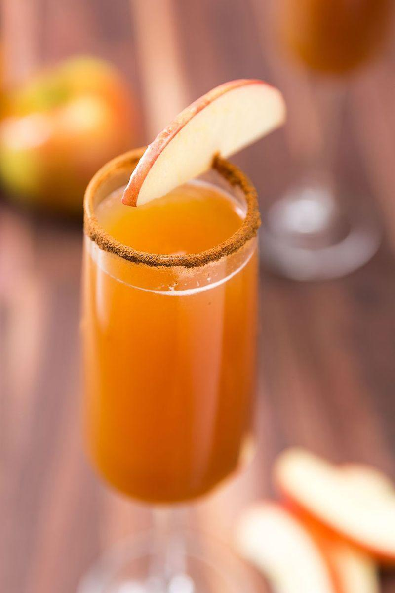 """<p>We're obsessed with apple cider and these <a href=""""https://www.delish.com/uk/cocktails-drinks/a30924062/mimosa-cocktail/"""" rel=""""nofollow noopener"""" target=""""_blank"""" data-ylk=""""slk:mimosas"""" class=""""link rapid-noclick-resp"""">mimosas</a> are the only thing you need in your hand.</p><p>Get the <a href=""""https://www.delish.com/uk/cocktails-drinks/a32027975/apple-cider-mimosas-recipe/"""" rel=""""nofollow noopener"""" target=""""_blank"""" data-ylk=""""slk:Apple Cider Mimosas"""" class=""""link rapid-noclick-resp"""">Apple Cider Mimosas</a> recipe.</p>"""