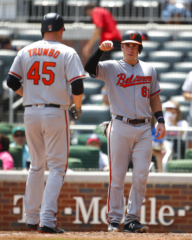 Baltimore Orioles' Mark Trumbo (45) celebrates his two-run home run with teammate Austin Wynns (61) in the fifth inning of a baseball game against the Atlanta Braves, Sunday, June 24, 2018, in Atlanta. (AP Photo/Todd Kirkland)
