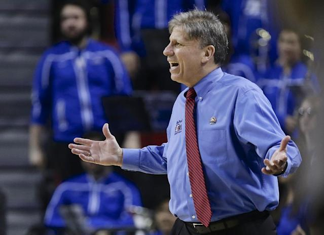 DePaul coach Doug Bruno disputes a call by an official during the first half of a regional semifinal against Texas A&M in the NCAA women's college basketball tournament in Lincoln, Neb., Saturday, March 29, 2014. (AP Photo/Nati Harnik)