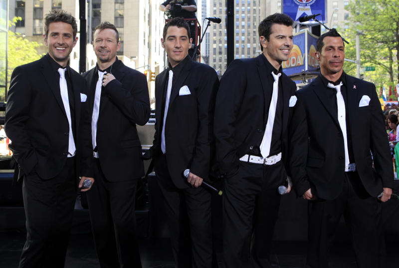 "FILE - This May 8, 2009 file photo shows members of New Kids on the Block, from left, Joey McIntyre, Donnie Wahlberg, Jonathan Knight, Jordan Knight, and Danny Wood on the NBC ""Today"" television program in New York. The New Kids on the Block, Aerosmith, James Taylor, and Jimmy Buffett are among the scheduled performers for a Boston Marathon benefit concert May 30. The show, at the TD Garden, will benefit One Fund _ the collection of donations that will be distributed to the survivors of the April 15 bombings and the families of those killed in the attack."" (AP Photo/Richard Drew)"