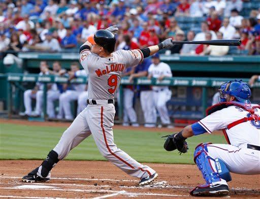 Baltimore Orioles' Nate McLouth (9) follows through on his swing for a double as Texas Rangers catcher Geovany Soto looks on during the first inning of a baseball game, Monday, Aug. 20, 2012, in Arlington, Texas. (AP Photo/Jim Cowsert)