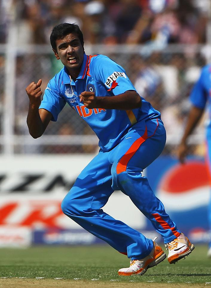 AHMEDABAD, INDIA - MARCH 24:  Ravichandran Ashwin of India celebrates, after bowling Shane Watson of Australia during the 2011 ICC World Cup Quarter Final match between Australia and India at Sardar Patel Stadium on March 24, 2011 in Ahmedabad, India.  (Photo by Matthew Lewis/Getty Images)