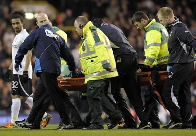 "Bolton's English midfielder Fabrice Muamba is stretched from the pitch while being treated by medical staff after collapsing during the English FA Cup quarter-final football match between Tottenham Hotspur and Bolton Wanderers at White Hart Lane in north London, England on March 17, 2012. The game was abandoned at half-time as Muamba was taken to hospital. RESTRICTED TO EDITORIAL USE. No use with unauthorized audio, video, data, fixture lists, club/league logos or ""live"" services. Online in-match use limited to 45 images, no video emulation. No use in betting, games or single club/league/player publications (Photo by Olly Greenwood/AFP/Getty Images)"
