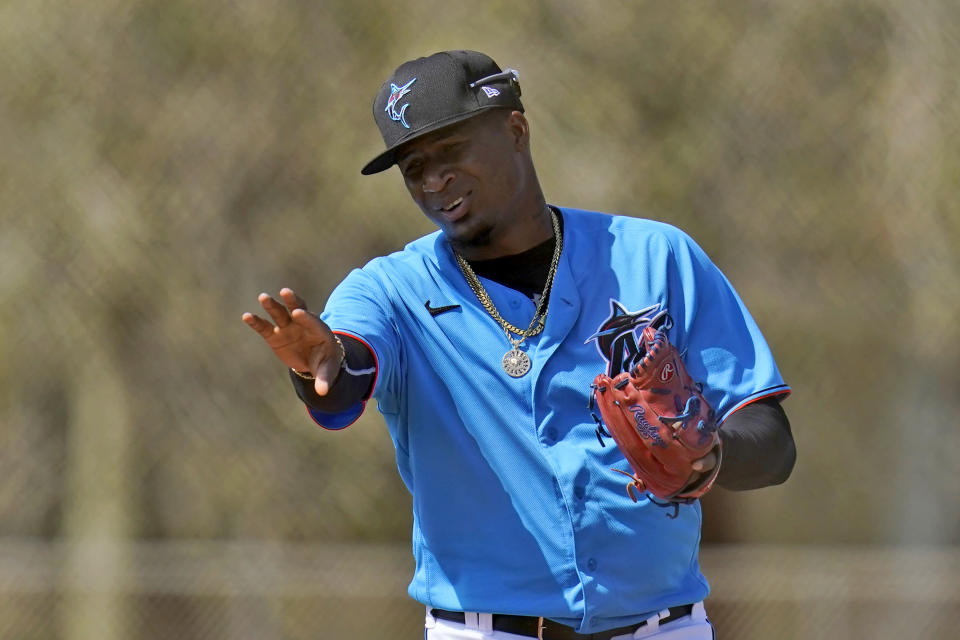 FILE - Miami Marlins pitcher Sixto Sanchez gestures while talking to a teammate during spring training baseball practice in Jupiter, Fla., in this Friday, Feb. 26, 2021, file photo. None of the eight pitchers in the mix for the rotation is older than 25. (AP Photo/Jeff Roberson, File)