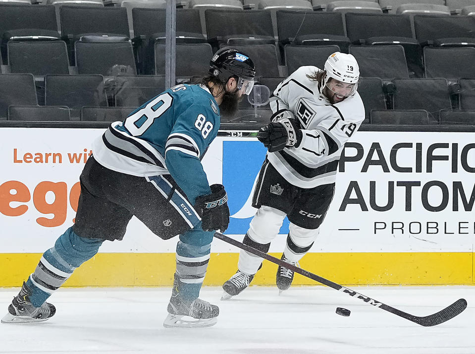 Los Angeles Kings right wing Alex Iafallo (19) takes a shot at goal past San Jose Sharks defenseman Brent Burns (88) during the second period of an NHL hockey game Friday, April 9, 2021, in San Jose, Calif. (AP Photo/Tony Avelar)