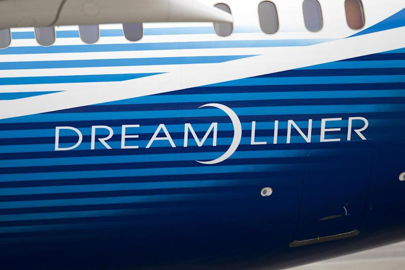 "FILE - In this May 7, 2012, file photo, a Boeing 787 Dreamliner arrives at Ronald Reagan National Airport as part of a worldwide ""Dream Tour"" in Washington. While Boeing's 787 Dreamliners are grounded, the batteries causing airliner's troubles can still fly. At the time the government certified the 787 as safe, federal rules barred the type of batteries used to power the airliner's electrical systems from being carried as cargo on passenger planes because of the fire risk. But new rules exempt aircraft batteries from the ban on large lithium ion batteries as cargo on flights by passenger planes. (AP Photo/Evan Vucci, File)"