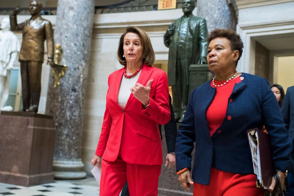 Speaker Nancy Pelosi (left) and Rep. Barbara Lee walk through the Capitol. Lee has led the fight to repeal the 2001 Authorization for Use of Military Force, which the House passed Wednesday. (Photo: Tom Williams via Getty Images)