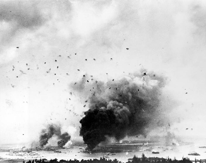 <p>Flak bursts of anti-aircraft shells pepper the skyline above rising smoke from the battleship USS Arizona during the Japanese raid on Pearl Harbor on Dec. 7, 1941. (U.S. Navy/National Archives/Handout via Reuters) </p>
