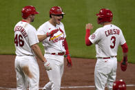 St. Louis Cardinals' Nolan Arenado is congratulated by teammates Paul Goldschmidt (46) and Dylan Carlson (3) after hitting a three-run home run during the third inning of a baseball game against the New York Mets Monday, May 3, 2021, in St. Louis. (AP Photo/Jeff Roberson)