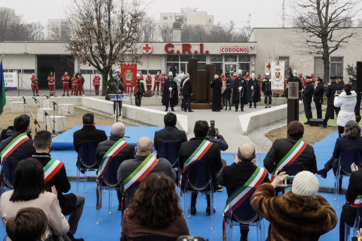 Authorities unveil a memorial for Covid deaths, in Codogno, northern Italy, Sunday, Feb. 21, 2021. The first case of locally spread COVID-19 in Europe was found in the small town of Codogno, Italy one year ago on February 21st, 2020. The next day the area became a red zone, locked down and cutoff from the rest of Italy with soldiers standing at roadblocks keeping anyone from entering of leaving. (AP Photo/Luca Bruno)