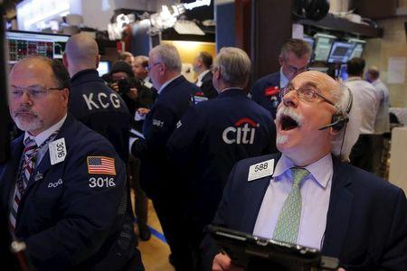 Traders work on the floor of the New York Stock Exchange shortly before the closing bell in New York