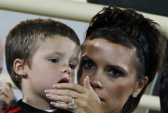 Victoria Beckham and her son Cruz while watching a match between AC Milan and Hamburg SV in Dubai, January 6, 2009.