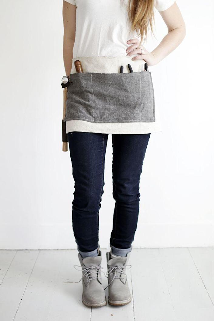 """<p>Is your mom big into fixing things around the house? Then this handmade work apron is the perfect gift to present her with.</p><p><strong>Get the tutorial at <a href=""""https://themerrythought.com/diy/diy-waxed-canvas-tool-apron/"""" rel=""""nofollow noopener"""" target=""""_blank"""" data-ylk=""""slk:A Merry Thought"""" class=""""link rapid-noclick-resp"""">A Merry Thought</a>.</strong></p><p><strong><a class=""""link rapid-noclick-resp"""" href=""""https://go.redirectingat.com?id=74968X1596630&url=https%3A%2F%2Fwww.walmart.com%2Fbrowse%2Farts-crafts-sewing%2Fcraft-storage%2F1334134_6355365_1285843&sref=https%3A%2F%2Fwww.thepioneerwoman.com%2Fholidays-celebrations%2Fgifts%2Fg32307619%2Fdiy-gifts-for-mom%2F"""" rel=""""nofollow noopener"""" target=""""_blank"""" data-ylk=""""slk:SHOP CRAFT STORAGE"""">SHOP CRAFT STORAGE</a><br></strong></p>"""