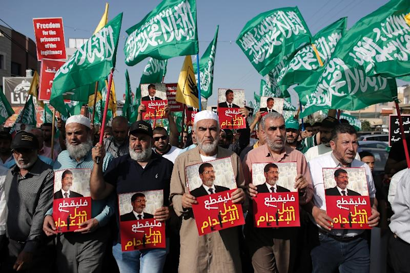 Leader of the radical northern wing of the Islamic Movement in Israel, Sheikh Raed Salah (C), attends a demonstration against the death sentence of Egypt's ousted president Mohamed Morsi in Kfar Kana, northern Israel on May 23, 2015