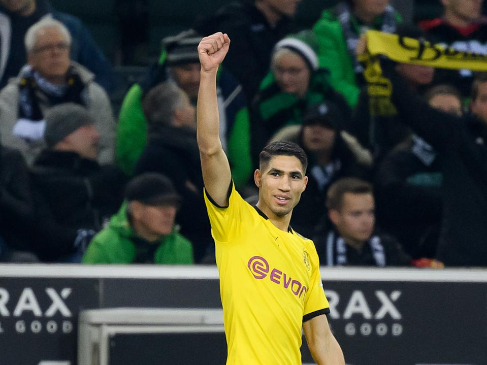 MOENCHENGLADBACH, GERMANY - MARCH 07: (BILD ZEITUNG OUT) Achraf Hakimi of Borussia Dortmund celebrates after scoring his team's second goal during the Bundesliga match between Borussia Moenchengladbach and Borussia Dortmund at Borussia-Park on March 7, 2020 in Moenchengladbach, Germany. (Photo by Alex Gottschalk/DeFodi Images via Getty Images)