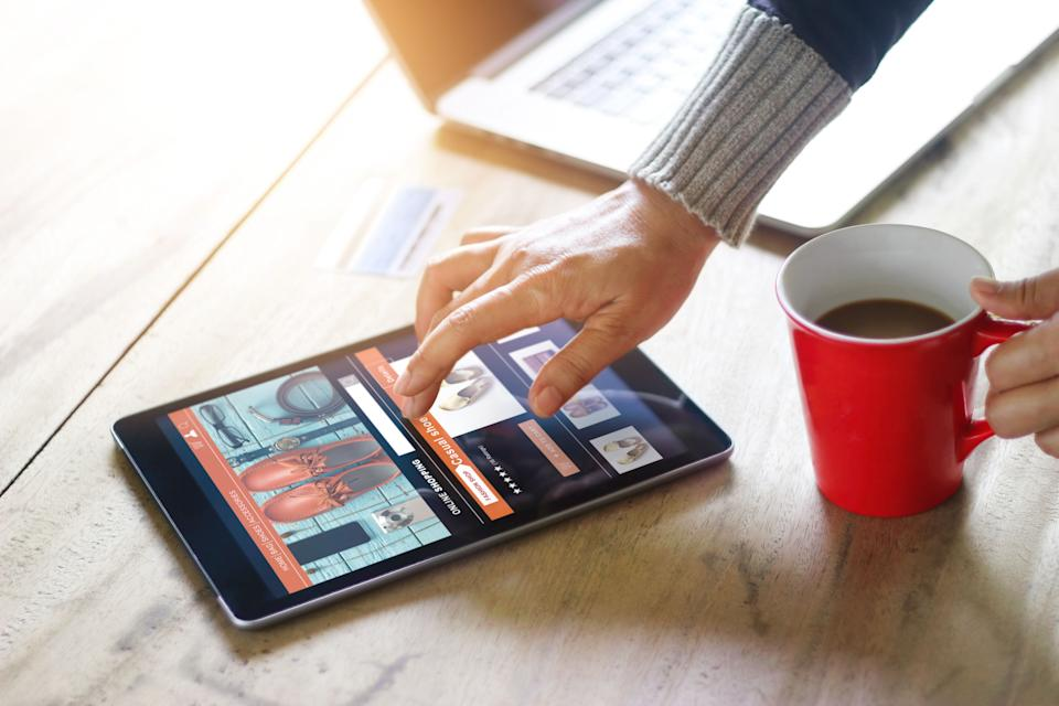 Woman shopping online at home, business and modern lifestyle concept, all on tablet screen are designed up