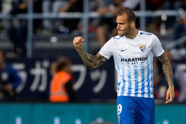 Malaga's forward Sandro Ramirez celebrates after scoring during the Spanish league football match Malaga CF vs Sevilla FC at La Rosaleda stadium in Malaga on May 1, 2017