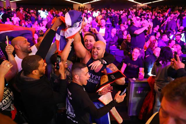 <p>Yancy Reyes celebrates with friends after defeating Eneorji Brooks in the 19th Precinct Grudge Match at the NYPD Boxing Championships at the Hulu Theater at Madison Square Garden on March 15, 2018. (Gordon Donovan/Yahoo News) </p>