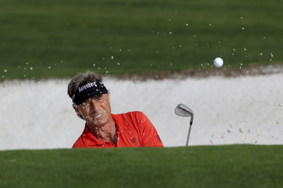 Bernhard Langer hits out of a bunker on the 9th hole to finish his first round of the Masters Friday, Nov. 13, 2020, in Augusta, Ga. (Curtis Compton/Atlanta Journal-Constitution via AP)