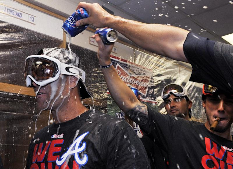 Playoff chase: A's, Braves, Cards clinch
