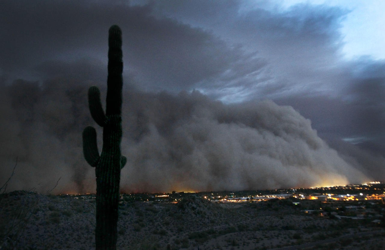 A giant dust storm covers Phoenix, Tuesday, July 5, 2011. (AP Photo/The Arizona Republic, Rob Schumacher)