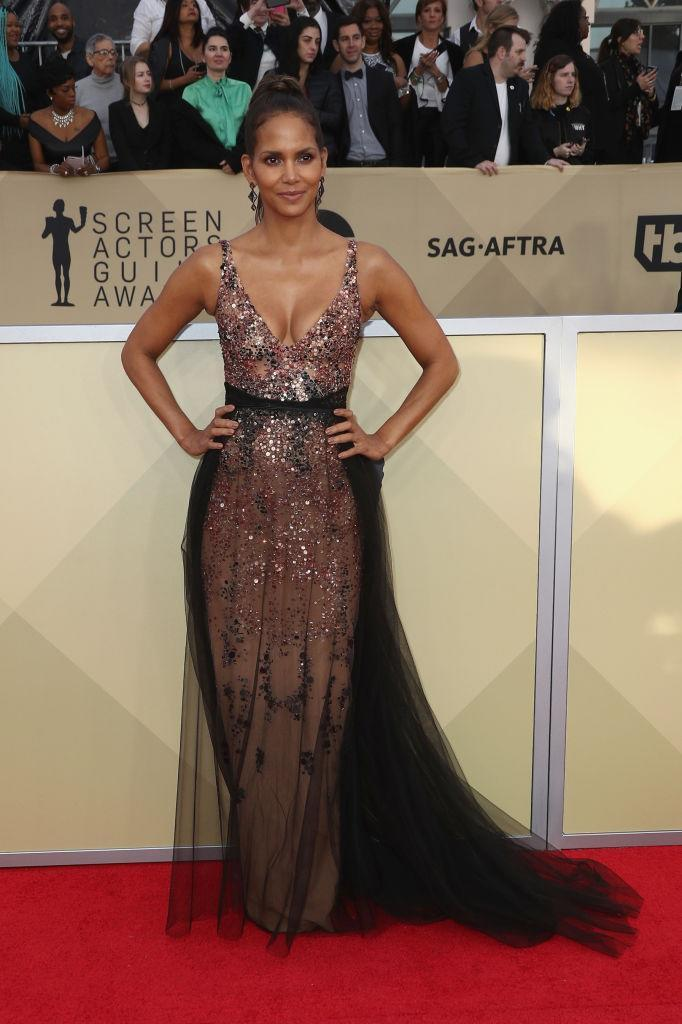 <p>The actress wore a sequined dress with a see-through tulle skirt. (Photo: Getty Images) </p>