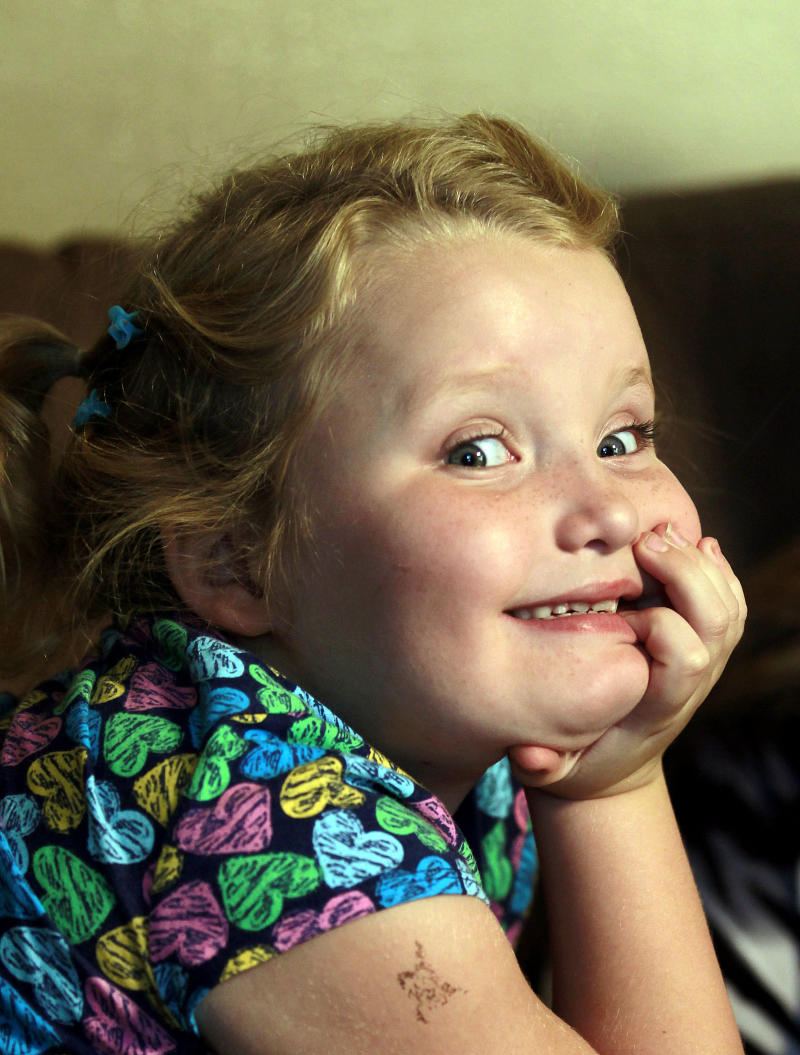 """FILE - This Sept. 10, 2012, file photo shows seven-year-old beauty queen and reality show star Alana """"Honey Boo Boo"""" Thompson at her home in McIntrye , Ga., Alana and her family are featured on the hit show """"Here Comes Honey Boo Boo"""". The TLC network said Wednesday that it has ordered Halloween, Thanksgiving and Christmas specials focusing on its seven-year-old breakout star Honey Boo Boo. The series airs its 10th and final episode of its debut season on Wednesday, Sept. 26. (AP Photo/John Bazemore, file)"""