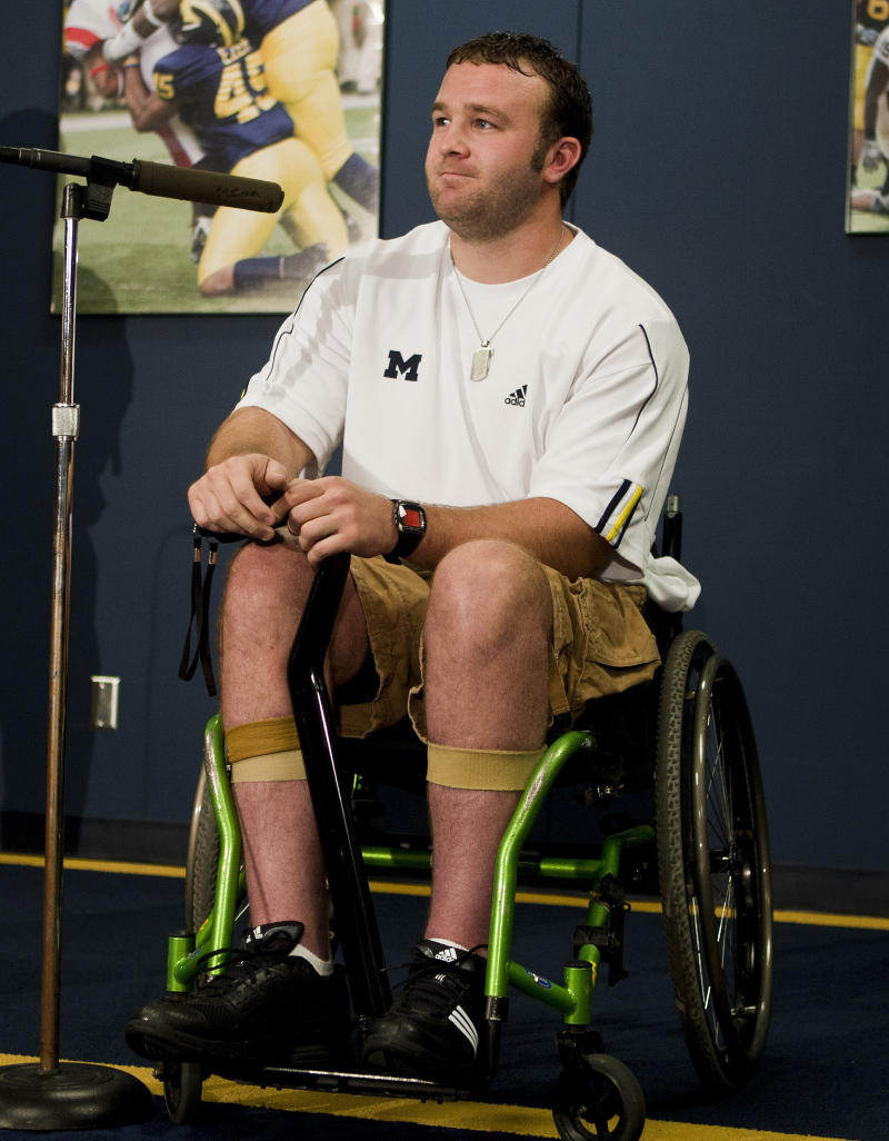 FILE - In this Aug. 22, 2010, file photo, Brock Mealer, brother of Michigan offensive lineman Elliott Mealer, speaks about the training he has received from Michigan's strength coaches to help in his recovery from a car accident. Even though Brock will be rooting for the Wolverines on Saturday, Nov. 27, 2010, at Ohio Stadium, he has a unique perspective on the rivalry: He's seen the best of both sides. (AP Photo/Tony Ding, File)