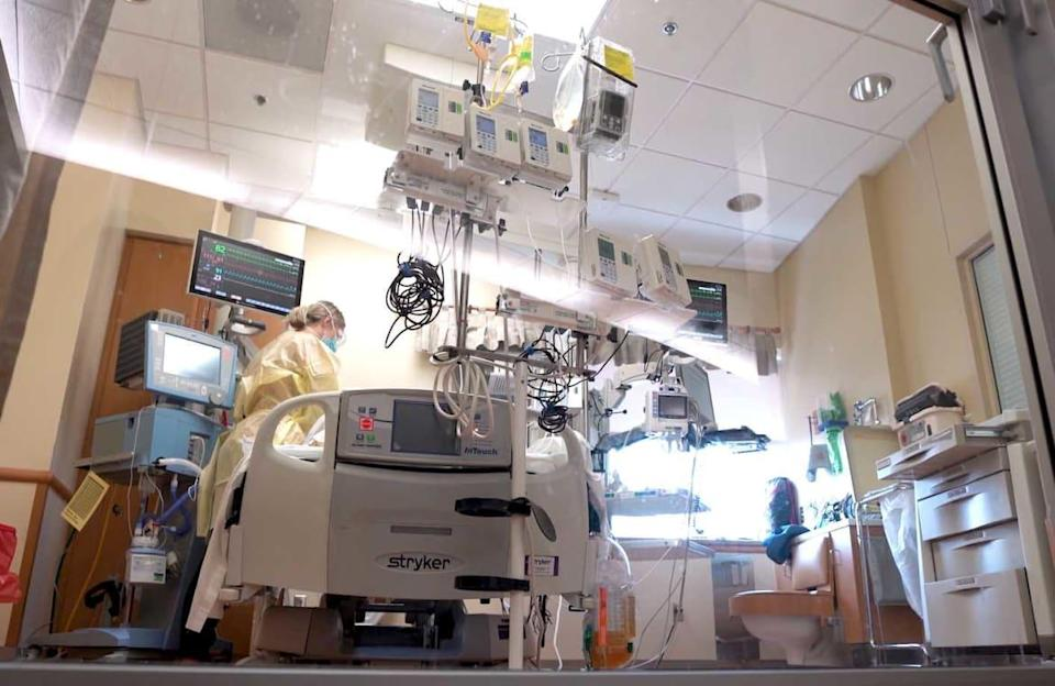 """<div class=""""inline-image__caption""""><p>""""Brennan Magagna, RN, works at the bedside of a COVID-19 patient in the Intensive Care Unit at Saint Alphonsus Regional Medical Center in Boise, ID.""""</p></div> <div class=""""inline-image__credit"""">Courtesy Saint Alphonsus Health System</div>"""