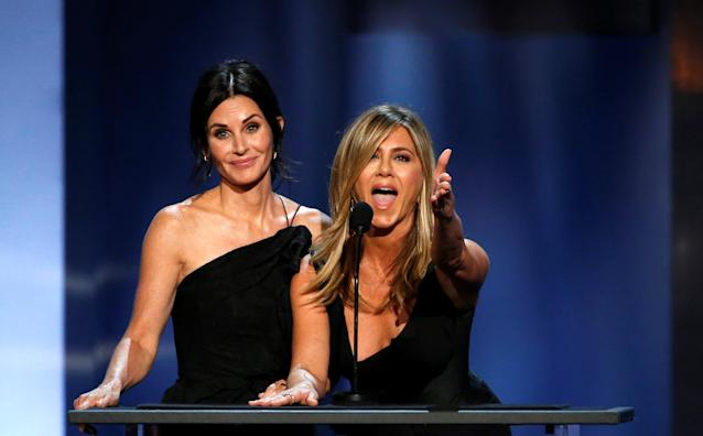 Actors Jennifer Aniston and Courteney Cox speak at the 46th AFI Life Achievement Award in Los Angeles on June 7, 2018. (Mario Anzuoni/Reuters)