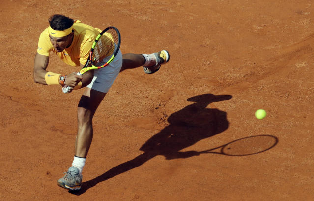 Spain's Rafael Nadal returns the ball to Canada's Denis Shapovalov, at the Italian Open tennis tournament in Rome, Thursday, May 17, 2018 (AP Photo/Alessandra Tarantino)