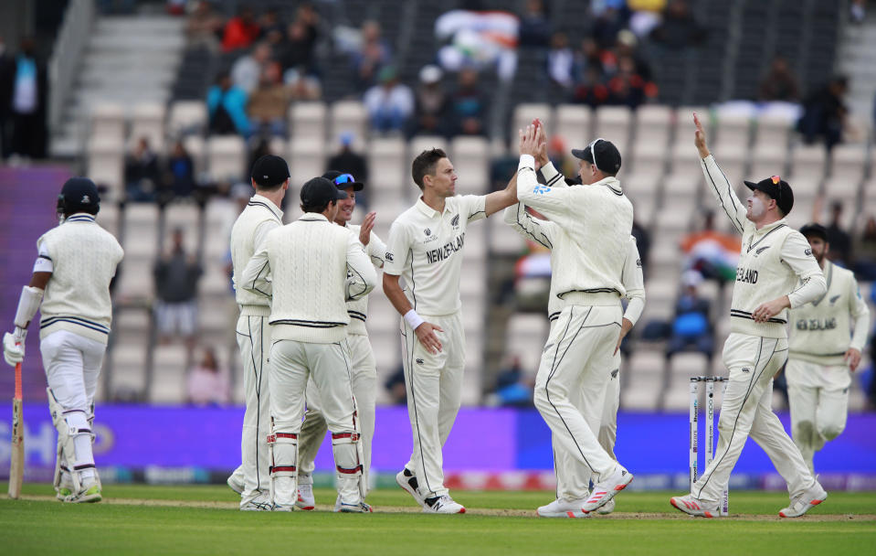 New Zealand's Trent Boult, center, celebrates with teammates the dismissal of India's Cheteshwar Pujara, left, during the second day of the World Test Championship final cricket match between New Zealand and India, at the Rose Bowl in Southampton, England, Saturday, June 19, 2021. (AP Photo/Ian Walton)