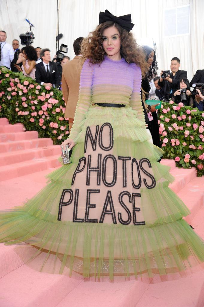 """Hailee wore a multicolored tiered ball gown with the words """"No photos please"""" embroidered across the front"""