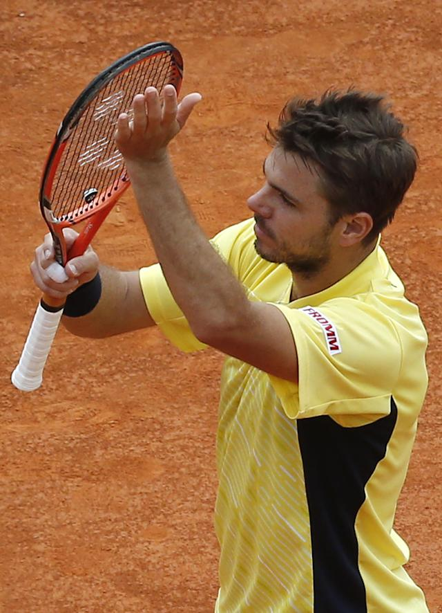 Stanislas Wawrinka of Switzerland acknowledges applause after defeating Milos Raonic of Canada during their quarterfinals match of the Monte Carlo Tennis Masters tournament in Monaco, Friday, April 18, 2014. Wawrinka won 7-6 6-2. (AP Photo/Michel Euler)