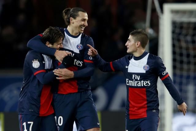 Paris St Germain's Zlatan Ibrahimovic (C) celebrates between Maxwell (L) and Marco Verratti after he scored against FC Sochaux during their French Ligue 1 soccer match at the Parc des Princes Stadium in Paris December 7, 2013. REUTERS/Gonzalo Fuentes (FRANCE - Tags: SPORT SOCCER TPX IMAGES OF THE DAY)