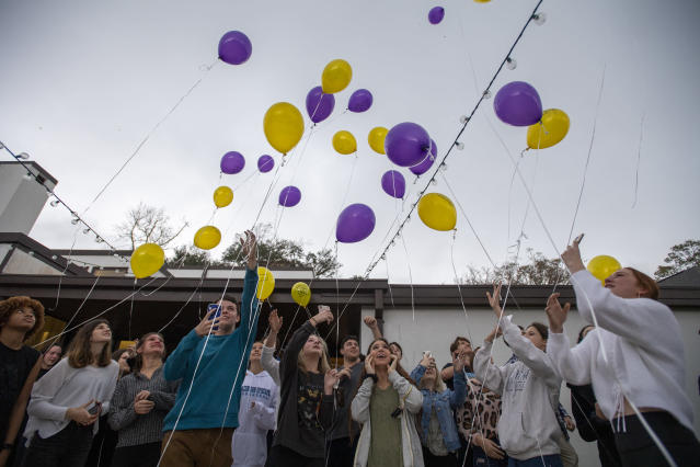 Balloons are released during a 16th birthday party for Walker Vincent at Leslie Jacob's home on Sunday, December 29, 2019 in Lafayette, La. Walker Vincent was one of the victims in the plane crash on Saturday. Family and friends threw him a birthday party where they released LSU balloons and marked gifts with their favorite memories of Walker for his father. (Brad Kemp/The Advocate via AP)